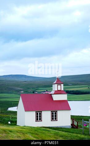 Hill, lake, Svinavatn, church, Iceland - Stock Photo
