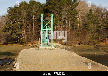 Wiggly Bridge in York, Maine USA during the spring months. This small foot bridge was built in the 1930s and wiggles while you walk across it. - Stock Photo