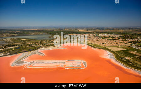 Salt evaporation ponds for salt production between Aigues-Mortes and Le Grau-du-Roi, Fleur de sel, Petite Camargue, Occitanie region, France - Stock Photo