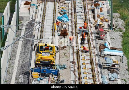 Construction site, construction vehicles, track construction, mechanics - Stock Photo