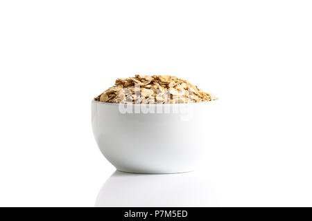 Isolation of gluten free oats in a cup on a white background. - Stock Photo