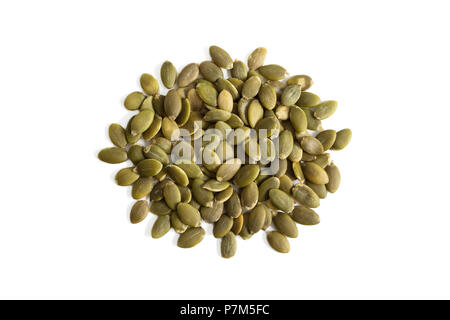 Isolated uncooked green pumpkin seeds on a white background from above. - Stock Photo
