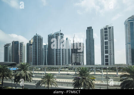 Futuristic view of Sheikh Zayed Road, a big highway in Dubai and a metro station, Dubai, United Arab Emirates - Stock Photo