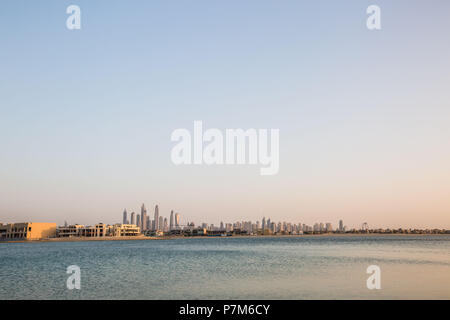 United Arab Emirates, Skyline of Dubai, taken from the palm area, sky, copy space - Stock Photo