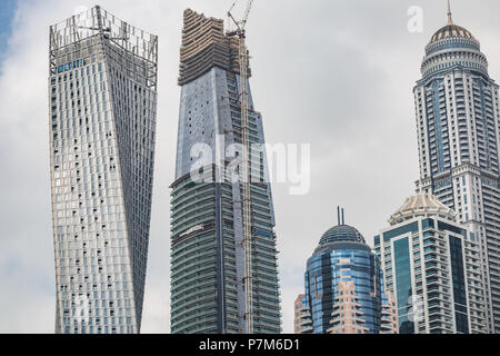 Perspective detailed view at a skyscrapers in Dubai, United Arab Emirates, Construction of a skyscraper - Stock Photo