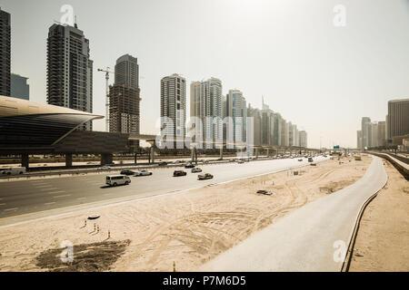 Futuristic skyline of Sheikh Zayed highway and metro station, Dubai, United Arab Emirates. - Stock Photo