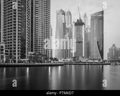 Monochrome panorama of the skyscrapers at Dubai Marina, United Arab Emirates - Stock Photo