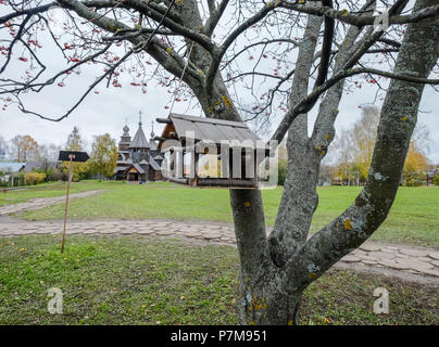 Hanging birdhouse on the tree at autumn in Suzdal, Russia. - Stock Photo