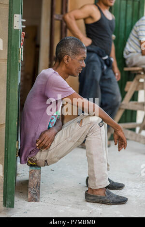 A man taking a break on a hot day in Havana, Cuba. - Stock Photo
