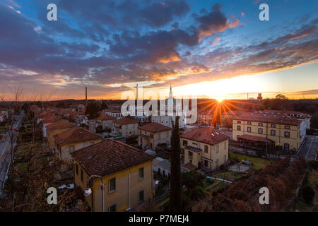 Winter sunset over the model worker village of Crespi d'Adda, Unesco World Heritage Site. Capriate San Gervasio, Bergamo province, Lombardy, Italy, - Stock Photo