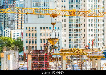 Kiev, Ukraine - July 4, 2018: Workers are working at a construction site. Concrete and roofing construction work is carried out. - Stock Photo