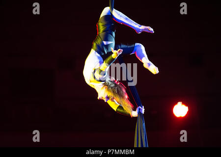 Belarus, Gomel, April 1, 2018. Gomel State Circus. Performance of the team of the Moscow circus Nikulin.Acrobat on the canvases. Gymnast the circus ac - Stock Photo