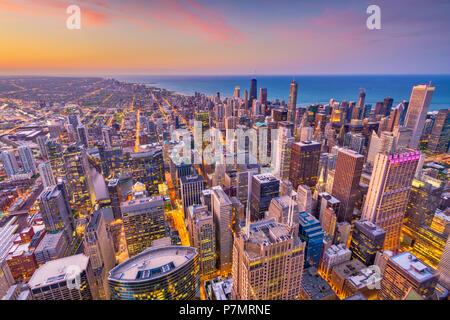 Chicago, Illinois, USA aerial downtown skyline at dusk towards Lake Michigan. - Stock Photo