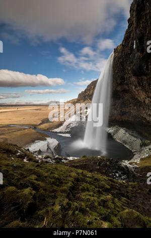 Seljalandsfoss waterfall in winter day, Sudurland, south Iceland, Iceland, Europe, - Stock Photo