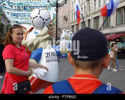 St. Petersburg, Russia - June 17, 2018: Football fans make photo at Zabivaka mascot on Nevsky avenue during FIFA World Cup Russia 2018. Saint Petersbu - Stock Photo