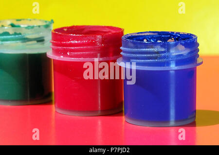 Open containers with gouache on the table - Stock Photo
