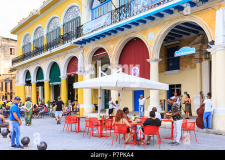 Plaza Vieja, people and tourists walking on popular square with restored historic buildings in Habana Vieja, Havana, Cuba - Stock Photo