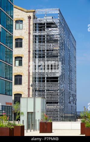Fabulous metal screen with cut out lettering on one end of the former Warehouse which is now Les Docks Village, a Marseille shopping and office centre - Stock Photo