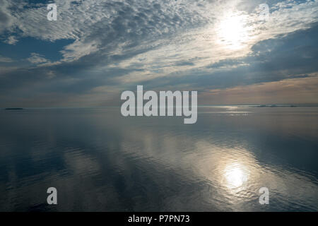 beautiful morning sun over the ocean seen from a cruise ship in denmark - Stock Photo