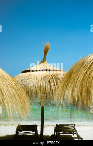 Umbrella and Lounge Chairs on the Beach in Mallorca With Copy Space - Stock Photo