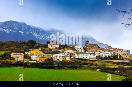 Galdeano village (Allin) and Loquiz mountain range.  Navarre, Spain, Europe. - Stock Photo