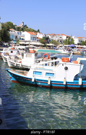 Local fishing boats moored in the old harbour at Skiathos Town, Skiathos Island, GREECE, PETER GRANT - Stock Photo