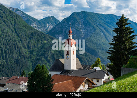 30 june 2018: View of the little village of Assling (Tyrol region, Austria) with the Tyrolean alps in the background - Stock Photo