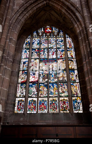 Beautiful satined glass windows inside the St. Lawrenz Chuch in Nuremburg, Germany. - Stock Photo