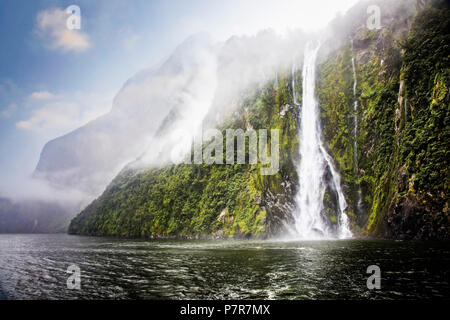 Water from rainfall cascades down mountainsides. Milford Sound in Fiordland, South Island, New Zealand. - Stock Photo