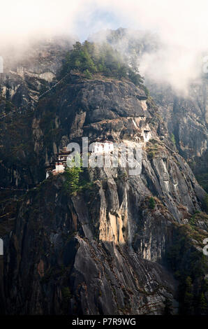 Paro Taktsang is the popular name of Taktsang Palphug Monastery or Tigers Nest outside of Paro, Bhutan in the foothills of the Himalaya. - Stock Photo
