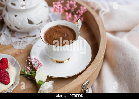 White and pink flowers. Breakfast in bed. Flavored coffee. Delicate light colors. Romance. Place for text. - Stock Photo