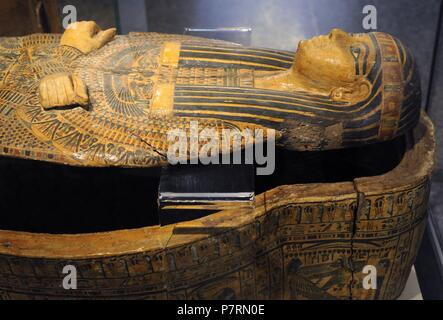 Egypt. Sarcophagus cover, The priestly from Deir-el Bahri, near Luxor. Priest. 21st Dynasty. Third Intermediate Period. Decorated: crossed arms, false beard, painting on a yellow background, lacquer. Historical Museum. Oslo. Norway. - Stock Photo