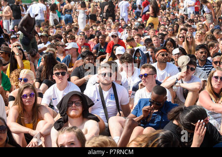Festivalgoers watch England play Sweden in the world cup, on the second day of the Wireless Festival, in Finsbury Park, north London. PRESS ASSOCIATION Photo. Picture date: Saturday July 7th, 2018. Photo credit should read: Matt Crossick/PA Wire. - Stock Photo