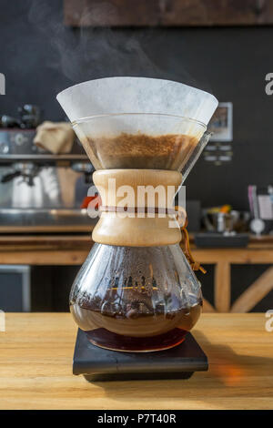 Close-up of brewing coffee in chemex - Stock Photo