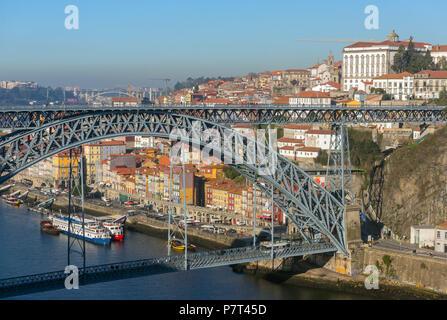 View of the historic city center with the famous ponte Dom Luiz bridge in Porto, Portugal - Stock Photo