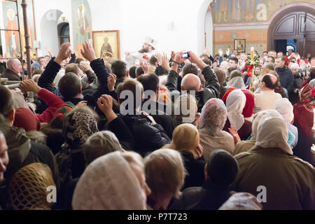 Belarus, Gomel, on April 8, 2018. The Nikolsky Monastery. The celebration of Orthodox Easter. A crowd of believers in the church. Many people in the c - Stock Photo