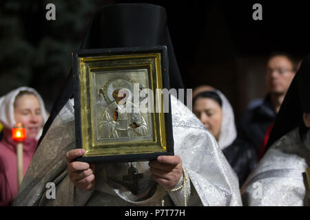 The priest holds the icon - Stock Photo