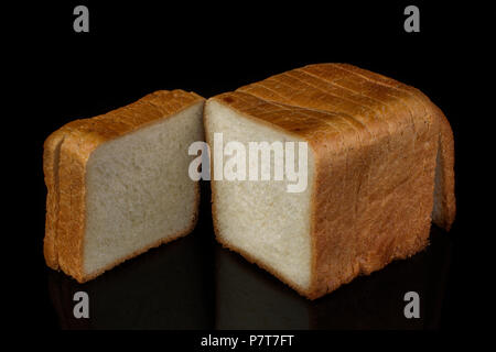 White bread for toast on a black background - Stock Photo