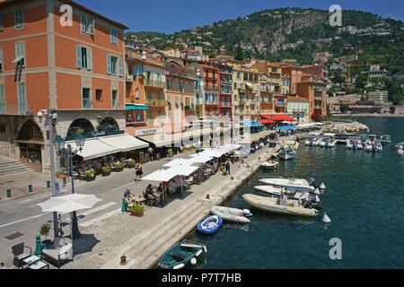 ROW OF RESTAURANTS ALONGSIDE THE WATERFRONT (aerial view from a 6-meter mast). Villefranche-sur-Mer, French Riviera, France. - Stock Photo