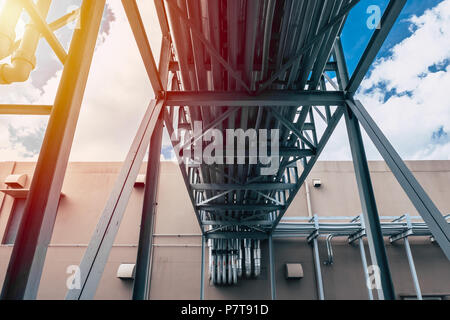 Industrial Pipe. Group of Factory Heat Pipe Water Chilling Air Ventilation transfer metal pipelines between building - Stock Photo