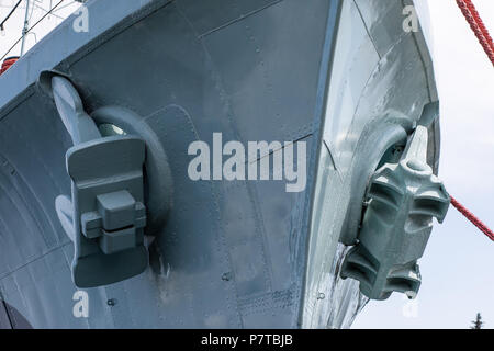 Ship anchor suspended on the side. Port in central europe. Season of the summer. - Stock Photo