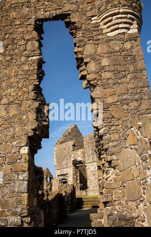 UK, Northern Ireland, Co Antrim, Dunluce Castle, Manor House through gatehouse - Stock Photo