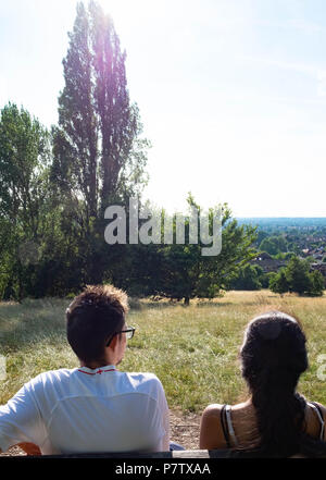 London, England. 7th July 2018. Ekta and Dan enjoying the view over Harrow in the sunshine. The present heatwave is set to continue. ©Tim Ring/Alamy Live News - Stock Photo