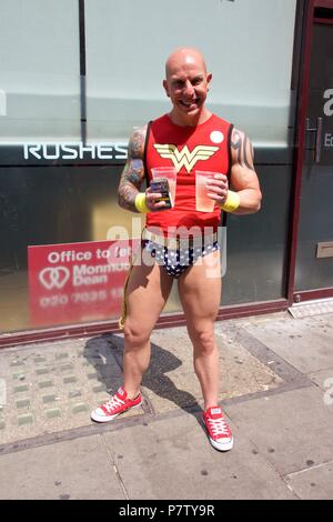 London, UK. 7th July 2018. Pride celebrations in London.A man in Soho dressed as Wonder Woman to celebrate Pride in London 2018. Credit: Dimple Patel/Alamy Live News - Stock Photo