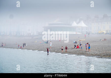 Aberystwyth Wales UK, 08 July 2018,   UK Weather:  A misty morning in Aberystwyth, as the sea mist rolls in off Cardigan Bay to take the edge off the temperatures on the west wales coast.  Over much of the UK  the prolonged  heat wave and very dry weather continues unbroken, with temperatures expected to climb again towards the end of the week  photo credit Keith Morris / Alamy Live News - Stock Photo