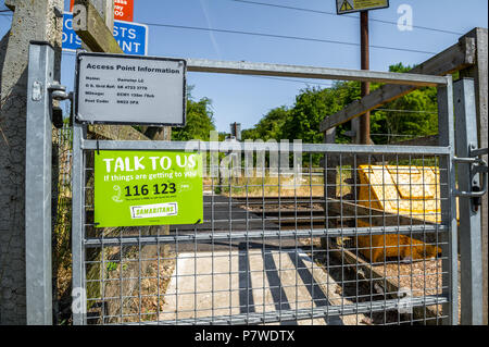 Samaritans notice 'talk to Us' at a level crossing footpath on the East Coast Main Line railway. - Stock Photo