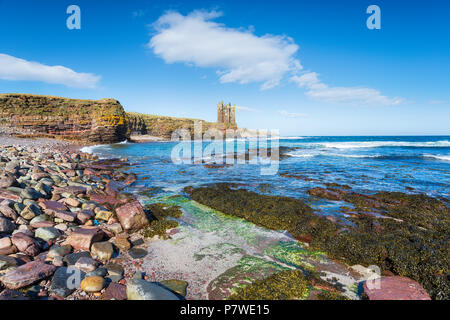 The ruins of Keiss castle perched on a cliff in the far north east of Scotland - Stock Photo