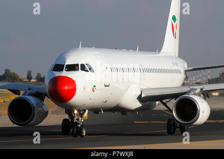 Danish Air Transport Airbus A320 jet plane taxiing for departure. Modern aviation. Closeup front view. - Stock Photo