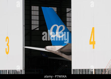 Airplane tail with Air Europa logo in a hangar during maintenance - Stock Photo