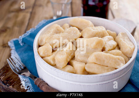 Homemade dumplings with cheese and vanilla. In a rustic style, in a ceramic cup. Healthy vegetarian food. Home cooking. Russian kitchen. - Stock Photo